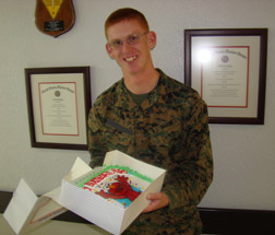 A Lance Corporal celebrates with a personalized cake sent from his parents