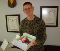 A Lance Corporal celebrates with personalized cake sent by his parents