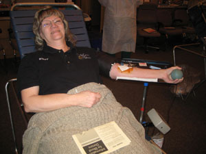 Secretary donating blood